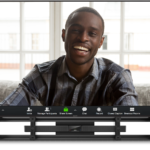 Leon Speakers and Bose Videobar below a tv with person smiling on screen.