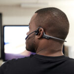 Person wearing OpenComm UC headset