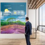 Mockup of Philips X-Line Videowall showcasing the weather while a person stands in front of it.